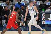 Dallas Mavericks guard Luka Doncic (77) helping to bring the ball up court while being guarded by Toronto Raptors forward OG Anunoby (3) during an NBA basketball game, Saturday, Nov. 16, 2019, in Dallas. The Mavericks defeated the Raptors 110-102. (Wayne Gooden/Image of Sport)