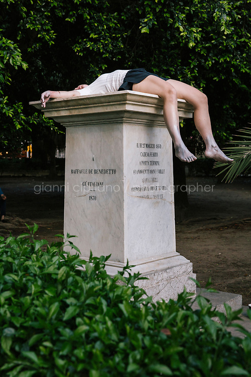 PALERMO, ITALY - 16 JUNE 2018: A performance takes place in the Garden of Villa Garibaldi in Piazza Marina as part of a collateral event of Manifesta 12, the European nomadic art biennal, in Palermo, Italy, on June 16th 2018.<br /> <br /> Manifesta is the European Nomadic Biennial, held in a different host city every two years. It is a major international art event, attracting visitors from all over the world. Manifesta was founded in Amsterdam in the early 1990s as a European biennial of contemporary art striving to enhance artistic and cultural exchanges after the end of Cold War. In the next decade, Manifesta will focus on evolving from an art exhibition into an interdisciplinary platform for social change, introducing holistic urban research and legacy-oriented programming as the core of its model.<br /> Manifesta is still run by its original founder, Dutch historian Hedwig Fijen, and managed by a permanent team of international specialists.<br /> <br /> The City of Palermo was important for Manifesta&rsquo;s selection board for its representation of two important themes that identify contemporary Europe: migration and climate change and how these issues impact our cities.