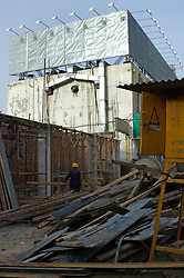 China, Beijing, Chaoyang, San Jian Fang, 2008. Within a month of its destruction, the San Jian Fang corner seen in #13 of this series rises again, construction nearly matching the pace of demolition..