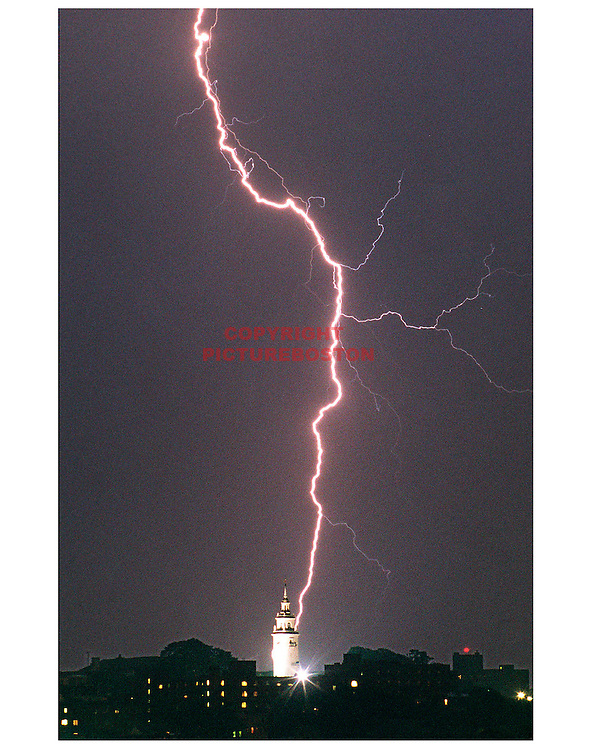 Lightning strikes over and behind South Boston's Dorchester Heights memorial on Telegraph Hill.