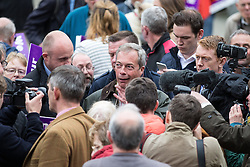© Licensed to London News Pictures . 25/05/2016 . Bolton , UK . NIGEL FARAGE surrounded by supporters and media . The UKIP referendum bus tour , campaigning for a UK Brexit , lead by Nigel Farage , in Victoria Square , Bolton . Photo credit : Joel Goodman/LNP