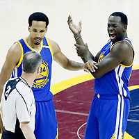 09 June 2017: Golden State Warriors guard Shaun Livingston (34) and Golden State Warriors guard Stephen Curry (30) talk to referee Mike Callahan (24) during the Cleveland Cavaliers 137-11 victory over the Golden State Warriors, in game 4 of the 2017 NBA Finals, at  the Quicken Loans Arena, Cleveland, Ohio, USA.