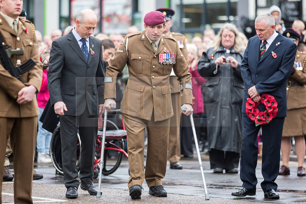 """© Licensed to London News Pictures. 08/11/2015. Doncaster, UK. Ben Parkinson, Britain's most badly injured surviving soldier at Remembrance Sunday in Doncaster wearing his full size Army uniform for the first time after getting new full-size prosthetic legs. Ben has now been restored to his full height with a pair of X3 Geniums prosthetic legs, which are taller than the ones he had previously and have """"intelligent technology"""". Former paratrooper Ben Parkinson, 30, was wounded when the vehicle in which he was travelling hit a mine in Helmand Province, Afghanistan, in 2006. Ben suffered the loss of both of his legs, severe brain injuries and a broken spine in the blast.  Photo credit: Andrew McCaren/LNP"""