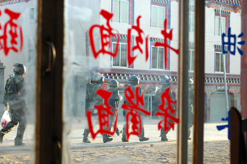 Chinese soldiers in Ganzi - letters read 'pork noodle soup' - Michael Benanav - March 23, 2008