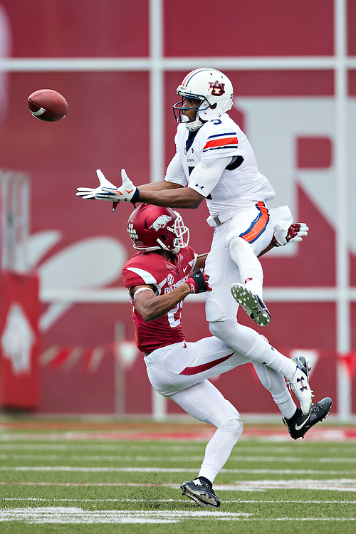 FAYETTEVILLE, AR - OCTOBER 24:  Ricardo Louis #5 of the Auburn Tigers drops a pass while being covered by Jared Collins #29 of the Arkansas Razorbacks at Razorback Stadium Stadium on October 24, 2015 in Fayetteville, Arkansas.  The Razorbacks defeated the Tigers in 4 OT's 54-46.  (Photo by Wesley Hitt/Getty Images) *** Local Caption *** Ricardo Louis; Jared Collins
