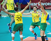 Brazil's Oliveira Raphael De Vieira (left) Bruno Mossa Rezende (centre)  and Luiz Felipe Marques  Fonteles  celebrate after winnig the match between France and Brazil during the 2014 FIVB Volleyball World Championships at Spodek in Katowice on September 20, 2014.