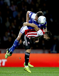 Birmingham City's Harlee Dean, (left) battles for possession of the ball with Brentford's Neal Maupay (right)