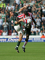 Photo: Lee Earle.<br /> Southampton v Plymouth Argyle. Coca Cola Championship. 24/09/2005. Plymouth's Micky Evans and Darren Powell battle for the ball.