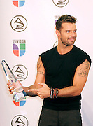 Grammy Man of the Year winner Ricky Martin poses in the press room at the 7th Annual Latin Grammy Awards at Madison Square Garden  on Thursday, November 2, 2006 in New York.