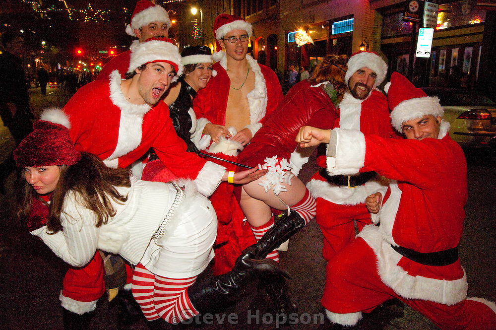 Santas at Santa Rampage 2009, Austin Texas, December 12, 2009. Santa Rampage is a mass gathering of Santas that happens each year in Austin along Sixth Street, and is also known as Santarchy or Santacon.