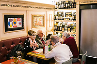 NAPLES, ITALY - 4 JANUARY 2019: Customers have lunch at Janarius, a restaurant in Naples, Italy, on January 4th 2019.<br /> <br /> Janarius is a typical Neapolitan gourmet restaurant and shop founded by Francesco Andoli in September 2018 in via Duomo, in front of the Naples's Duomo and treasure of Saint Janarius.