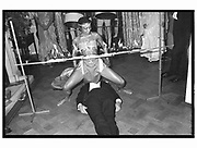 LORD NEWALL, under a limbo dancer, Party given by Mrs. Yousof Mazandi, Chester Sq. London. 6 May 1982.