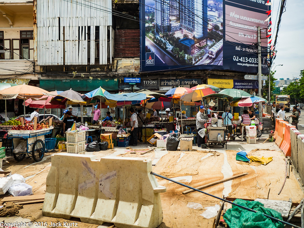 08 JUNE 2016 - BANGKOK, THAILAND:   What's left of a small street market for fruit and produce at the intersection of Phlap Phla Chai and Chareon Krung Streets in Bangkok's Chinatown neighborhood. The Bangkok Metropolitan Rapid Transit (MRT) system, Bangkok's subway, is being expanded through Chinatown and a station is under construction at the intersection. The small produce market at the intersection will have to move and several of the businesses near the intersection have been evicted to make way for the construction. Bangkok's Chinatown, considered by some to be one of the best preserved Chinatown districts in the world, is changing. Many of the old shophouses are being demolished and replaced by malls and condominium developments.    PHOTO BY JACK KURTZ