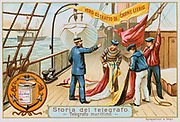 Aerial Telegraph:  Naval Semaphore.   Sailors hoisting flags which have been assembled to convey a message to a nearby vessel.  Liebig trade card issued c.1900. Chromolithograph .