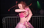A dancing clubber with pink braids and wearing a pink tutu skirt, Passion, Emporium, Milton Keynes, UK, 2002