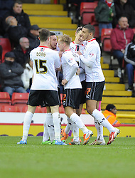 Milton Keynes Dons' Shaun Williams celebrates his goal with team mates  - Photo mandatory by-line: Joe Meredith/JMP - Tel: Mobile: 07966 386802 18/01/2014 - SPORT - FOOTBALL - Ashton Gate - Bristol - Bristol City v MK Dons - Sky Bet League One