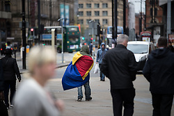 © Licensed to London News Pictures . 06/04/2017 . Manchester , UK . A man wrapped in a sleeping bag , walks through Piccadilly Gardens . An epidemic of abuse of the drug spice by some of Manchester's homeless population , in plain sight , is causing users to experience psychosis and a zombie-like state and is daily being witnessed in the Piccadilly Gardens area of Manchester , drawing large resource from paramedic services in the city centre . Photo credit : Joel Goodman/LNP