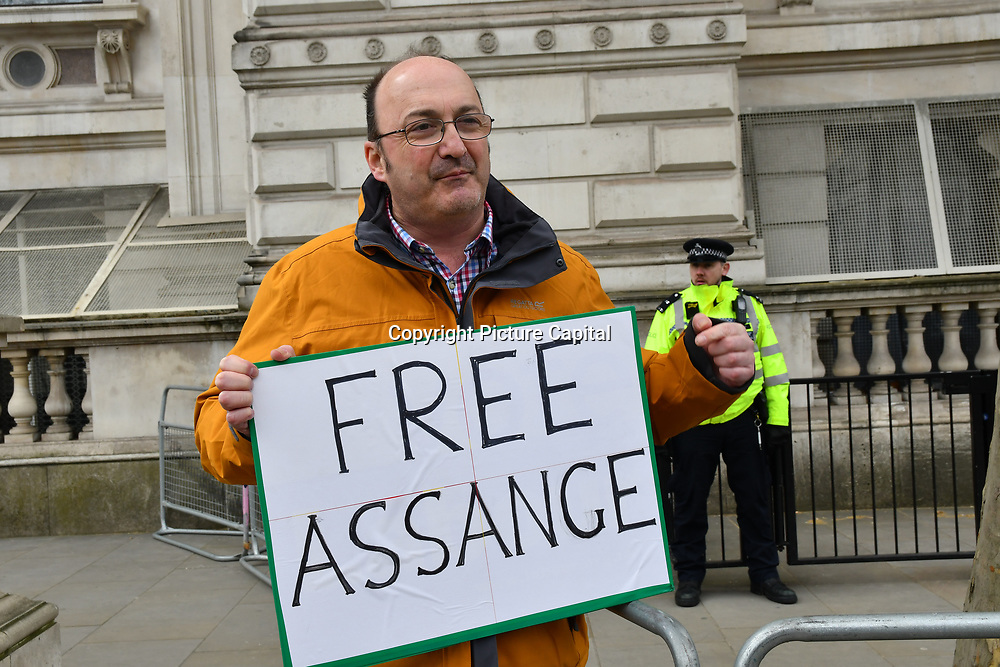 London, UK, 12 April 2019: Protest a guy holding a banner Free Assange Protesters says Everything is wrong in this country outside 10 Downing street, London, UK.
