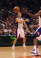 Oct. 22 2010; Phoenix, AZ, USA; Phoenix Suns point guard Steve Nash (13) makes a pass during the first half against Denver Nuggets during a preseason game at the US Airways Center. Mandatory Credit: Jennifer Stewart-US PRESSWIRE.