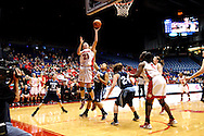 UD freshman Ally Malott (21) takes a shot as the Rhode Island Rams play the University of Dayton Flyers at UD Arena in Dayton, Saturday, January 7, 2012.