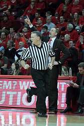 22 January 2014:  Mike Stuart runs past Head Coach Dan Muller during an NCAA Missouri Valley Conference mens basketball game between the Shockers of Wichita Stat and the Illinois State Redbirds  in Redbird Arena, Normal IL.