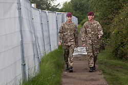 © licensed to London News Pictures. London, UK 19/07/2012. Two soldiers patrolling around the military base in Hainault Country Park in Redbridge, east London. The base will accommodate 3,000 soldiers during the Olympics. Photo credit: Tolga Akmen/LNP