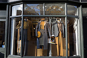 Three mannequins wearing Scottish tweed in a shop window near Covent Garden in the West End, on 22nd January 2019, in London England.