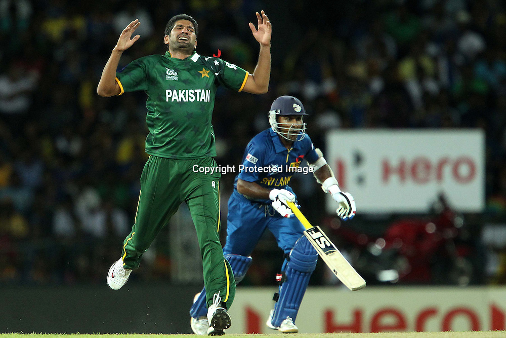 Sohail Tanvir reacts after bowling as Tilakaratne Dilshan makes the run during the ICC World Twenty20 semi final match between Sri Lanka and Pakistan held at the Premadasa Stadium in Colombo, Sri Lanka on the 4th October 2012<br /> <br /> Photo by Ron Gaunt/SPORTZPICS