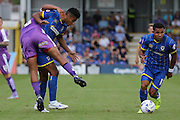 Andy Barcham of AFC Wimbledon runs with the ball while Lyle Taylor of AFC Wimbledon tussles during the Sky Bet League 2 match between AFC Wimbledon and Plymouth Argyle at the Cherry Red Records Stadium, Kingston, England on 8 August 2015. Photo by Stuart Butcher.