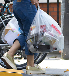 © Licensed to London News Pictures. 30/07/2018. London, UK.  Marina Thomas, Boris Johnson's wife takes out rubbish bags from the Foreign Secretary's official residence at Carlton Gardens in central London where the former Foreign Secretary, Boris Johnson is moving out following his resignation.  Photo credit: Vickie Flores/LNP
