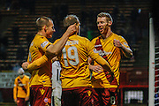 Motherwell FC Forward David Clarkson celebrates Motherwell FC Midfielder Stephen Pearson goal after his assist during the Ladbrokes Scottish Premiership match between Motherwell and Dundee at Fir Park, Motherwell, Scotland on 12 December 2015. Photo by Craig McAllister.