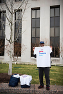 """Emond Allen sells t-shirts he made that read """"Love Trumps hair"""".<br /> <br /> (Washington D.C. - January 20, 2017)"""
