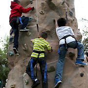 March 1, 2014, Palm Springs, California: <br /> Kids scale a rock climbing wall during Kids Day at the Indian Wells Tennis Garden sponsored by the Coachella Valley National Junior Tennis and Learning Network.<br /> (Photo by Billie Weiss/BNP Paribas Open)