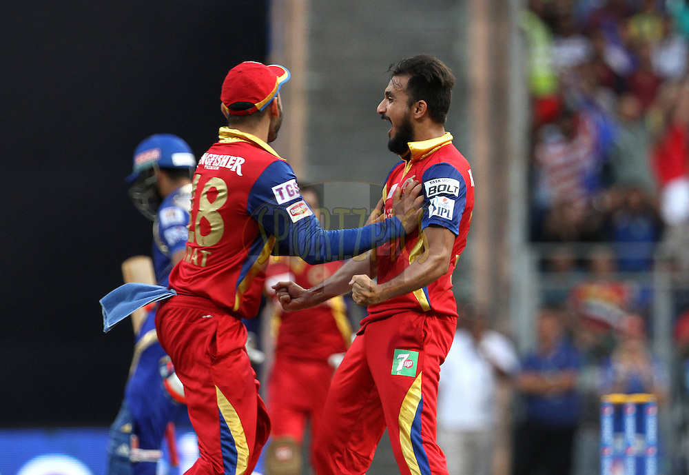 Royal Challengers Bangalore player Harshal Patel celebrates the wicket of Mumbai Indians captain Rohit Sharma during match 46 of the Pepsi IPL 2015 (Indian Premier League) between The Mumbai Indians and The Royal Challengers Bangalore held at the Wankhede Stadium in Mumbai, India on the 10th May 2015.<br /> <br /> Photo by:  Vipin Pawar / SPORTZPICS / IPL