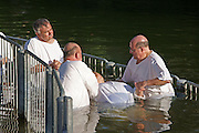 Israel, Yardenit Baptismal Site In the Jordan River Near the Sea of Galilee, A group of pilgrims being Baptized