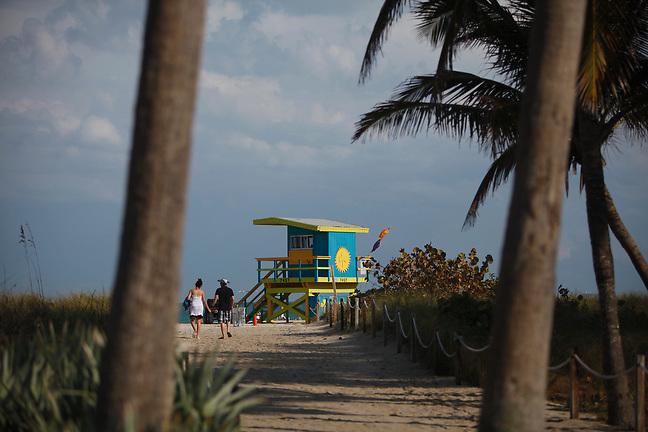 4/1/13---Miami Beach, Florida---Photo by Angel Valentin<br /> Walking to the beach in Miami Beach, near 71  Street.