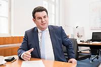 07 MAR 2019, BERLIN/GERMANY:<br /> Hubertus Heil, SPD, Bundesarbeitsminister, waehrend einem Interview, in seinem Buero, Bundesministerium fuer Arbeit und Soziales<br /> IMAGE: 20190307-01-017<br /> KEYWORDS: Büro