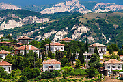Vilage with white houses near the mountain