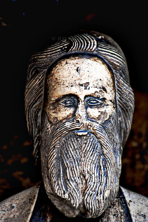 Detail, head of St. James, from the statue on the portal, right side.  Hair schematized in narrow parallel ridges; stern facial expression.