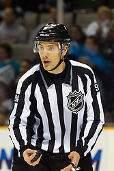 April 2, 2011; San Jose, CA, USA;  NHL linesman Bryan Pancich (94) before a face off between the San Jose Sharks and the Anaheim Ducks during the first period at HP Pavilion. San Jose defeated Anaheim 4-2. Mandatory Credit: Jason O. Watson / US PRESSWIRE