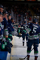 KELOWNA, CANADA - JANUARY 5: Austin Strand #2 and Jarret Tyszka #5 of the Seattle Thunderbirds fist bump the bench to celebrate a goal against the Kelowna Rockets on January 5, 2017 at Prospera Place in Kelowna, British Columbia, Canada.  (Photo by Marissa Baecker/Shoot the Breeze)  *** Local Caption ***