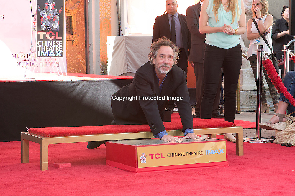 Legendary film director, writer and producer Tim Burton having his hand print in cement in the forecourt of the TLC Chinese Theatre in Hollywood this Thursday afternoon