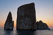 "Kicker Rock (Spanish name: ""Léon Dormido"") represents the remains of a lava cone, now split in two off the northwest coast of Isla San Cristóbal (Chatham Island), which is the easternmost of the Galápagos archipelago, governed by Ecuador, in South America. In 1959, Ecuador declared 97% of the land area of the Galápagos Islands to be Galápagos National Park, which UNESCO registered as a World Heritage Site in 1978. Ecuador created the Galápagos Marine Reserve in 1998, which UNESCO appended in 2001."