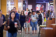 "25 NOVEMBER 2011 - PHOENIX, AZ:  Shoppers in Paradise Valley Mall Friday morning. ""Black Friday,"" the unofficial start of the holiday shopping season started even earlier than normal. Many stores, including Target and Best Buy, opened at midnight.    Photo by Jack Kurtz"