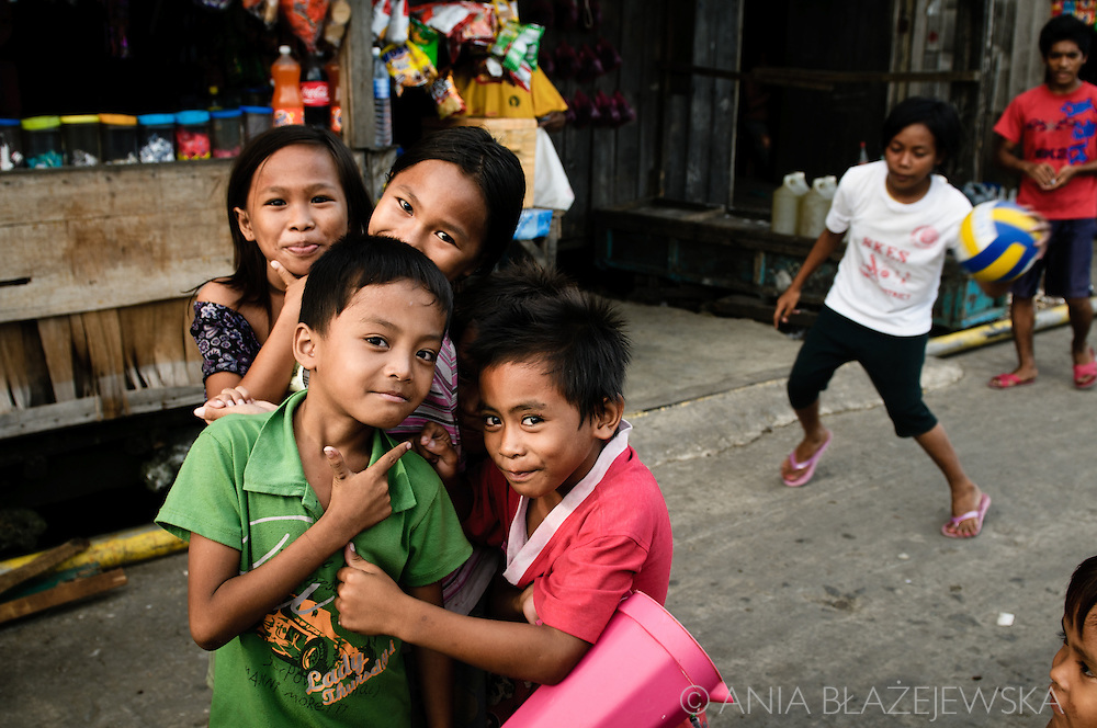 Philippines, Tawi Tawi. Children playing on the street of Bongao, capital of the province.
