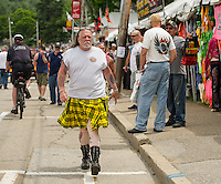 Jimi Ricci of Waltham Mass struts down Lakeside Avenue with a spring in his step and his kilt blowing in the breeze on Wednesday afternoon.  (Karen Bobotas/for the Laconia Daily Sun)
