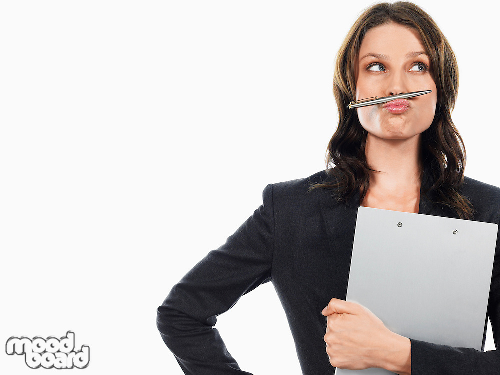 Businesswoman pulling funny face with pen