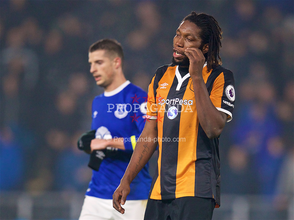 KINGSTON-UPON-HULL, ENGLAND - Friday, December 30, 2016: Hull City's Dieumerci Mbokani walks off dejected after his own goal gifted Everton and equalising goal in injury time of the first half during the FA Premier League match at the KCOM Stadium. (Pic by David Rawcliffe/Propaganda)