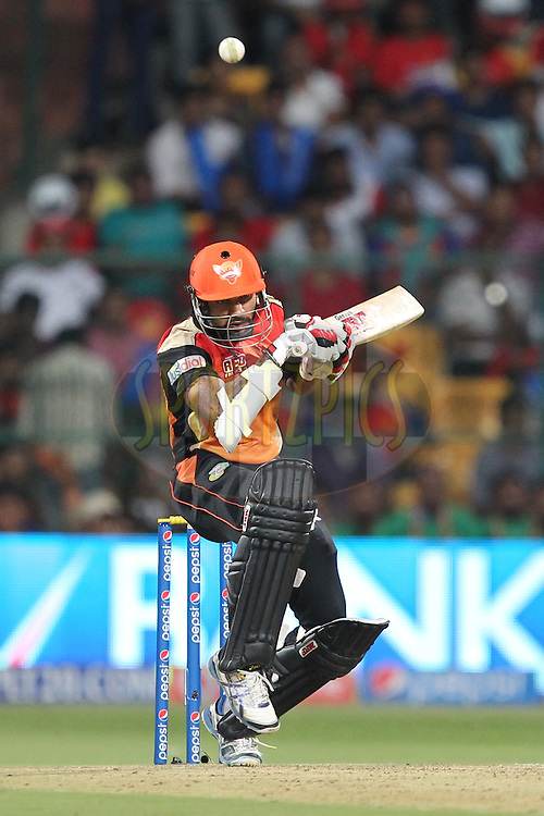 Shikhar Dhawan Captain of the Sunrisers Hyderabad ducks the bouncer during match 24 of the Pepsi Indian Premier League Season 2014 between the Royal Challengers Bangalore and the Sunrisers Hyderabad held at the M. Chinnaswamy Stadium, Bangalore, India on the 4th May  2014Photo by Prashant Bhoot / IPL / SPORTZPICSImage use subject to terms and conditions which can be found here:  http://sportzpics.photoshelter.com/gallery/Pepsi-IPL-Image-terms-and-conditions/G00004VW1IVJ.gB0/C0000TScjhBM6ikg