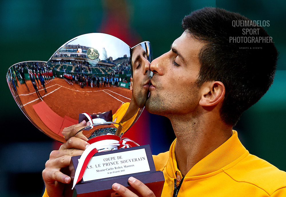MONTE-CARLO, MONACO - APRIL 19: Novak Djokovic of Serbia celebrates with the winners trophy after defeating Tomas Berdych of Czech Republic in the final during day eight of the Monte Carlo Rolex Masters tennis at the Monte-Carlo Sporting Club on April 19, 2015 in Monte-Carlo, Monaco. (Photo by Manuel Queimadelos)